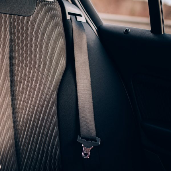 Modern car details, seatbelt on rear car seats with upholstery and security features