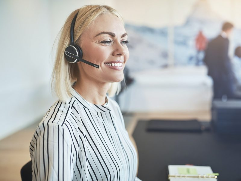 Young businesswoman smiling while talking on a headset